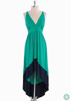"""Date Fun Colorblocked Curvy Plus Dress 42.99 at shopruche.com. We adore this luxuriously soft jersey maxi dress in teal that boasts a complementary navy hem, a flattering empire waist, and a playful asymmetrical hem. Finished with a glowing hint of sheen and the perfect touch of stretch for an oh-so-flattering silhouette. Partially lined.95% Rayon, 5% Spandex, Made in USA, 38"""" length from top of sho..."""