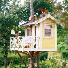 I sort of like this treehouse.  Think I would put the tree through the front porch and hold up the house with supports and footings.    That way there would be no worries about leaking nor would you have to enlarge the hole as the tree grew. A three or four inch space could be left completely around around the tree to allow for growth.