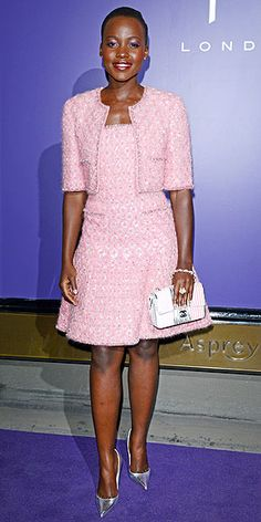Last Night's Look: Love It or Leave It? | LUPITA NYONG'O | How will we ever predict what color gown she'll wear to the Oscars?! The actress continues love affair with color, wearing a flippy cotton-candy-hued tweed Chanel dress under a cropped jacket, accessorized with silver Louboutins at the Charles Finch and Chanel pre-BAFTA party in London.