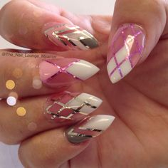 Stiletto nail art design done with acrylic powder