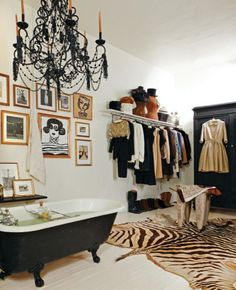 Chic urban apartment bathroom combined with closet & art gallery wall