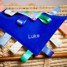 Baby taggie blankets not only make a great, playful comforter but are also a gorgeous keepsake. These gorgeous taggie blankets are handmade using bright blue super soft fleece. #personalised #bunting #giftguide #instagift #mumsinbusiness #blanket #taggies #unique #gift #babygifts #aprons #towels #instacool #fabric #nurserydecor #nursery #handmade #kidsgifts #giftideas #present #babyshower #christening #birthday #presents