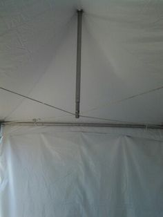 Using tensioned cord instead of cross-pieces - to adapt a centre and side poles tent to just side poles.