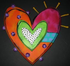 """*One of our favorite Quirky Pieces, we love having Tra Art Studio's Art brightening up our walls! This Art Heart is a combination of wood and metal. They are embellished to give added dimension.  Dimensions : 12"""" x 13"""" $99.95"""