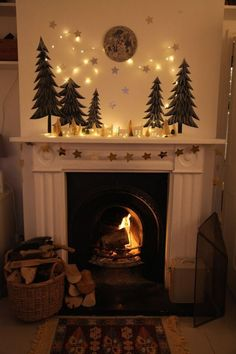 hearth mantel: evergreen trees, moon, ceramic house lanterns, string lights, gar… - All For Decoration