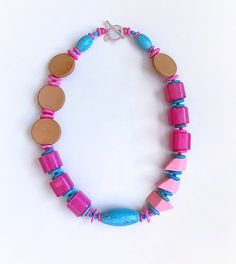 The Mega Baubler Necklace is just joyous to wear! The magenta acrylic beads, wood accents and magnesite gemstones create just the right combination for bold style and comfort. Bold Fashion, Acrylic Beads, Design Show, Daily Deals, Statement Jewelry, Magenta, Hot Pink, Beaded Necklace, Gemstones