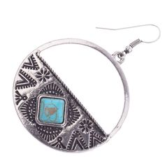 Another Native American inspired look! These round drop earrings have versatility with their antique silver look and beautiful turquoise stone detail. Wear them everywhere!