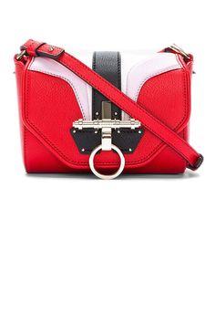 """Arch Leather Obsedia Shoulder Bag, $1,372 (on sale);  target=""""sale"""">ssense.com   - ELLE.com"""