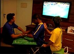 The friends who helped this deafblind Brazilian man experience the World Cup in real time. | 31 Moments That Restored Our Faith In Humanity In 2014