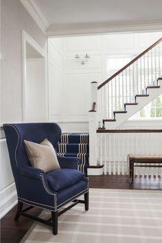 """Foyer. Foyer Furniture. Foyer Rug. Foyer Flooring. Foyer Millwork. Foyer Staircase. Foyer Paint Color. Foyer Layout. Foyer Decor. Foyer Furniture. Wall sconce is a """"Ralph Lauren Home Anette Swing Arm Sconce"""".  #Foyer. S. B. Long Interiors"""