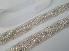 This dazzling bridal sash is embellished with luxurious rhinestones and pearls. The embellishment is 1 wide x 17 long (custom length also available-please convo us). The sash is made with double faced satin ribbon 7/8 wide and is 3 yards long. Stunning sash and much more beautiful in person.  PROCESSING: Please allow 3-5 business days for production. Also be sure to leave the date you require your order or your wedding date. For rush order, please convo us before placing your order.  SHI...