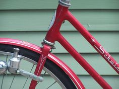 #Red Schwinn on green background
