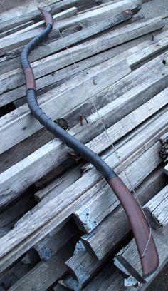 PVC Horse Bow custom - PVC, kangaroo leather, nylon cord, heat shrink.
