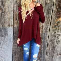 Up your basics game with this darling long-sleeved, laced neck shirt in four gorgeous colors. Trust us - you'll want to wear it every day. Did we mention it has a HOOD?   Pattern Type: Solid Fabric Type: Broadcloth Material: Cotton, Polyester, Spandex Collar: Hooded Sleeve Length: Long Color: Wine Red/Blue/Gray/Black Size: S/M/L/XL/XXL/XXXL/4XL/5XL - Fits true to size