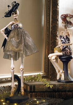 """Shockingly svelte and sporting the latest in """"haunt"""" couture, our Fashionista Skeletons would be right at home on a Paris runway, but they're most comfortable as stars of your Halloween décor."""