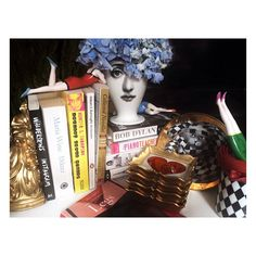 """#ChaosIsAFriendOfMine #BobDylan #GoodMorning #LoveMonday  Photo by @Zulphiya for @StockholmShoeicide  __________  Tema & Variazioni Vase & """"High Fidelity"""" tea sorcer  by #Fornasetti / Limited Edition Porcelain Figurines by Goebel Classics / Gilded Poker Themed Mini Trays by Stig Lindberg for Gustavsberg ( 1950s) / Red Silicon Cuff by #GaetanoPesce / Books as stated below  __________  #Fornasetti #PieroFornasetti #Bitossi #HighFidelity #Goebel #RoyalPorcelain #Gustavsberg #StigLindberg…"""