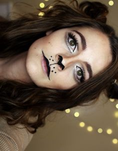 Lion Halloween Makeup look! This is a cute lion look with cat eyes with brown tones. Hair is curled and put into buns for the ears. Watch this tutorial on YouTube channel at Brittany O'Barr ♡