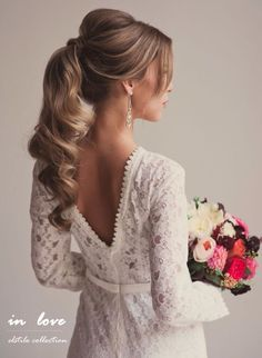 High ponytail wedding hairstyle looks quite pretty
