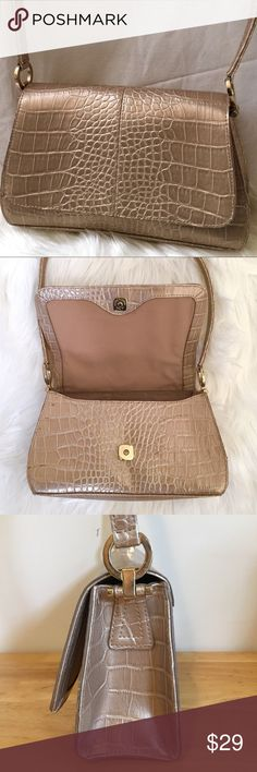 """Liz Claiborne Gold Faux Croc Shoulder Bag Liz Claiborne Baguette Style Shoulder Bag in Champagne Gold. The Faux Croc Embossed Purse has a Brass Magnetic Snap Closure with Gold (Brass) Strap Hardware. Inside is a Cotton Taupe Material with a Zippered Privacy Pocket. EUC. Exterior of Bag made of 100% Polyvinyl. Measurements:                                                   •Bag Dimensions 9.5  x 6.5 x 3.5                                 •Strap Drop 10.5"""" Liz Claiborne Bags Shoulder Bags"""