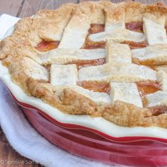 The only completely homemade peach pie recipe you'll ever need! Gooey peach filling with a flaky, buttery crust.