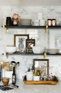 Curated kitchen shelves. For more, visit houseandleisure.co.za