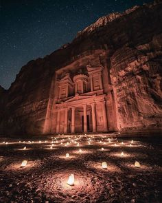 More than 2000 years ago Petra was an obligatory stop on the commercial routes. The rich merchants invested part of their money in building temples and tombs carved into the rock, but over time the routes were lost. By night, it transforms into what must be one of the most magical places in the world. Thousands of candles guide visitors through the Siq (a canyon) to the main square where the Treasury is located, making a visit to Petra by night one of the most unique things to do in Jordan. Travel And Leisure, Asia Travel, Bellisima, Location History, Adventure Travel, Landscape Design, Monument Valley, Mount Rushmore, Fotografia