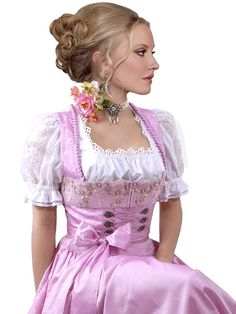 I dream of dressing my pretty boyfriend up in a pretty dirndl outfit someday. All of the bows and lace. He'd be so adorable!! Love to do his hair like this as well