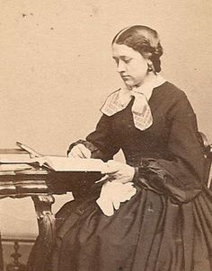 Maria Susanna Cummins (1827-1866).  Ah, here is someone actually reading a book from the stack of books on the table.