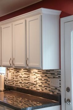 Upgrade your kitchen cabinets on a budget...paint, crown molding, granite-looking laminate countertops