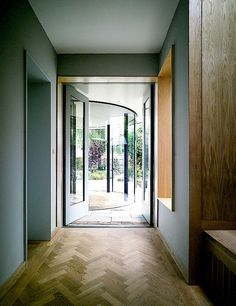 love the traditional flooring with ultra modern glass against duck egg blue