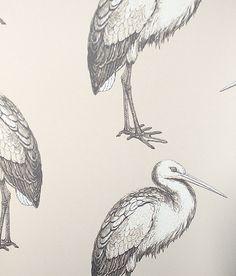 Laguna Wallpaper Large stork design in beige on taupe.