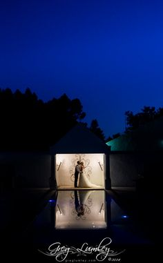 Bride and Groom photographed at night by Greg Lumley.  Greg Lumley loves doing a ten minute creative shoot after the sun goes down.