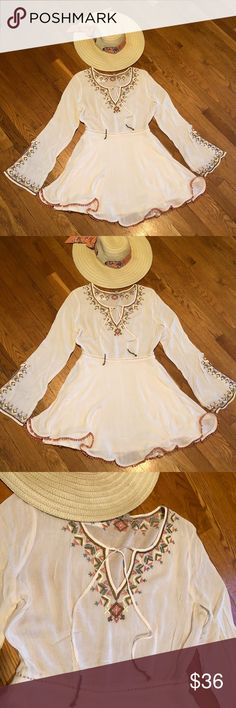 AMAZING Boho Dress Size 4 Cream with Floral NWOT Oh this dress... it is so adorable! Creamy white with floral embroidered detail and little pom poms along the bottom edge, total Boho look. Size 4. There is a lining in it also, it's a very well made item. The sleeves are slightly belled out with a 4-5 inch slit on sides (sorry for the wrinkles, it's been folded in my daughters drawer). NWOT never washed or worn. Ocote Dresses Mini
