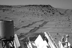 A new video shows NASA's Mars rover Curiosity playing dune buggy, clambering over a drift of sand on its way toward a big Red Planet mountain.