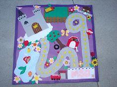 Girls felt activity mat. I can do this...scissors and a glue gun, right?!