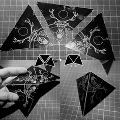 STEP 2: tape 3 leftover triangles (from STEP 1) together to form pyramids. We'll be using these as connector pieces in the final pattern