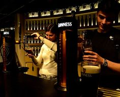 pouring some guinness pints. Ireland