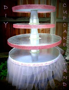 Inexpensive Cupcake Displays | Its perfect for a little princess's birthday tea party! I can recreate with a feather skirt and martini glasses to separate tiers.