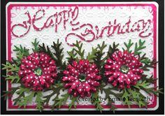 Pink Happy birthday using Tonic cornflower die, cheerylynn sentiment and spellbinders embossing folder. Paper flowers