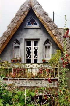 thatched cottage, balcony