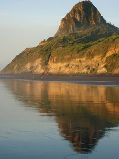 Reflection of Mt. Paratutu at Back Beach, New Plymouth, New Zealand