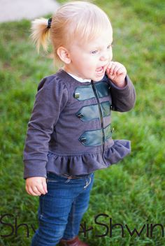 A free pattern and tutorial for a military inspired peplum knit jacket. Pattern includes sizes 12m-5Y.