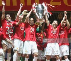 Carlos Tevez, Rio Ferdinand, Wes Brown, Ryan Giggs and Mikael Silvestre of Manchester United celebrate with the trophy after winning the UEFA Champions League Final match between Manchester United and Chelsea at Luzhniki Stadium on May 21 2008 in Moscow, Russia.