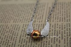the harry potter necklace the golden snitch antique jewelry steampunk gift on Etsy, $3.60