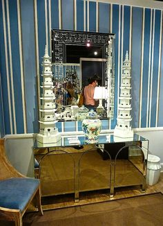 The Enduring Power of Blue at High Point Market, Spring 2014. Blue is a staple at Bungalow 5 and here showed off their new mirrored console optimally.