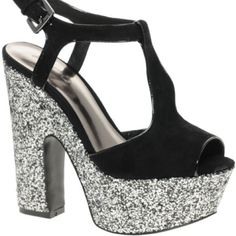 Aldo glitter platform sandals size 39 The top is suede and the platform is silver and black glitter. They are in good used condition and have a lot of life left in them. I'm listing them as an 8.5 they are a 39. I tend to wear a 8 or 8.5 which is almost always a 39 as well so if you are the same these should fit ALDO Shoes Sandals