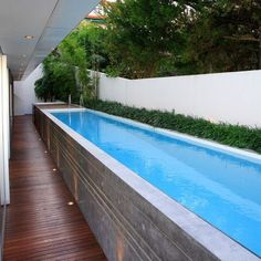 "<body><p>A lap pool is an excellent tool for staying fit, but as this design demonstrates, it can also be a <a rel=""nofollow"" href="" http://www.bobvila.com/diy-pond/44512-10-water-features-to-make-any-backyard-landscape-complete/slideshows?bv=yahoo"" title=""http://www.bobvila.com/diy-pond/44512-10-water-features-to-make-any-backyard-landscape-complete/slideshows"" target=""_blank"">stunning water feature</a>. This custom job is made from concrete but incorporates a hardwood deck, which adds…"