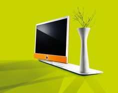 The new Loewe Connect ID, here shown on a Tableau stand with optional vase! There are two frames colours - black or white and the 'J' which wraps around the back of the TV can be black, white, silver, beige, green or orange!