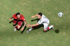 Hugo Almeida of Portugal and Mats Hummels of Germany battle for the ball during the 2014 FIFA World Cup Brazil Group G match between Germany and Portugal at Arena Fonte Nova on June 16, 2014 in Salvador, Brazil.