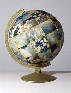 "Dreamlike atmosphere 1995 globe, peeled photographs, shellac 15"" x 13"" x 12"" Beverly Rayner"